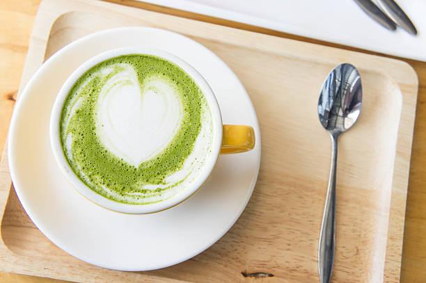 hot green tea milk cup and coffee cup and cake - grüner tee koffein stock-fotos und bilder