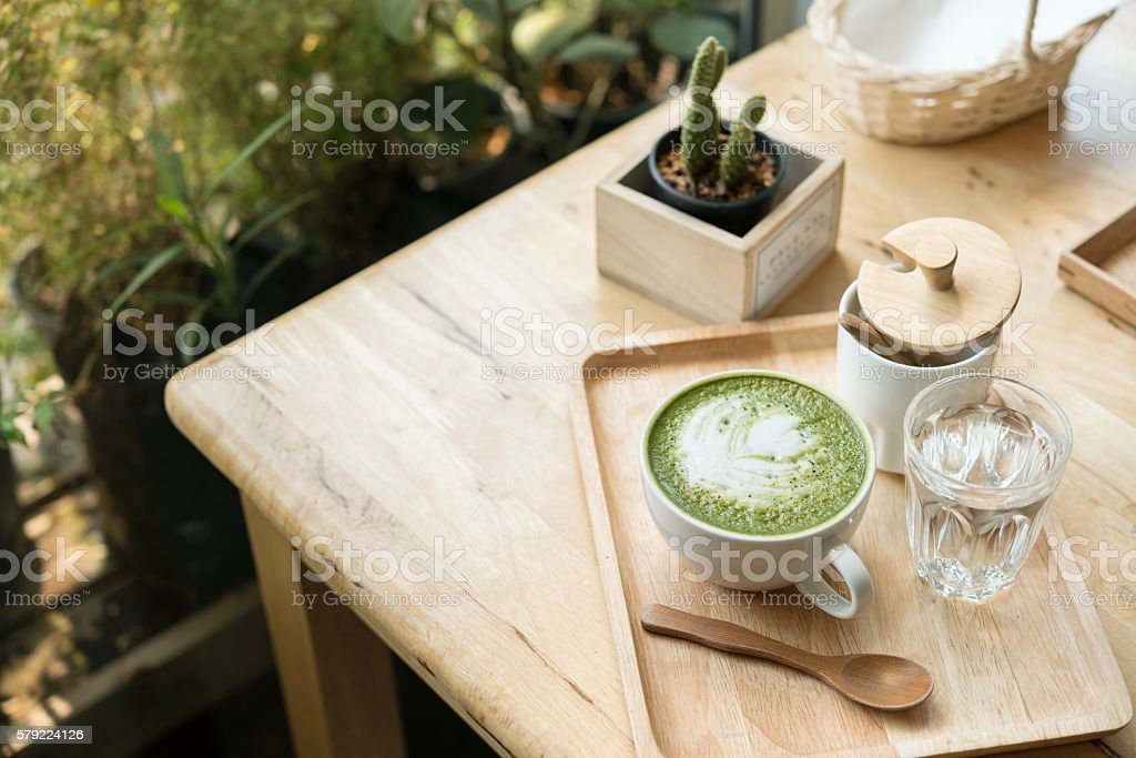 Hot green tea set on a wooden table in coffeshop stock photo