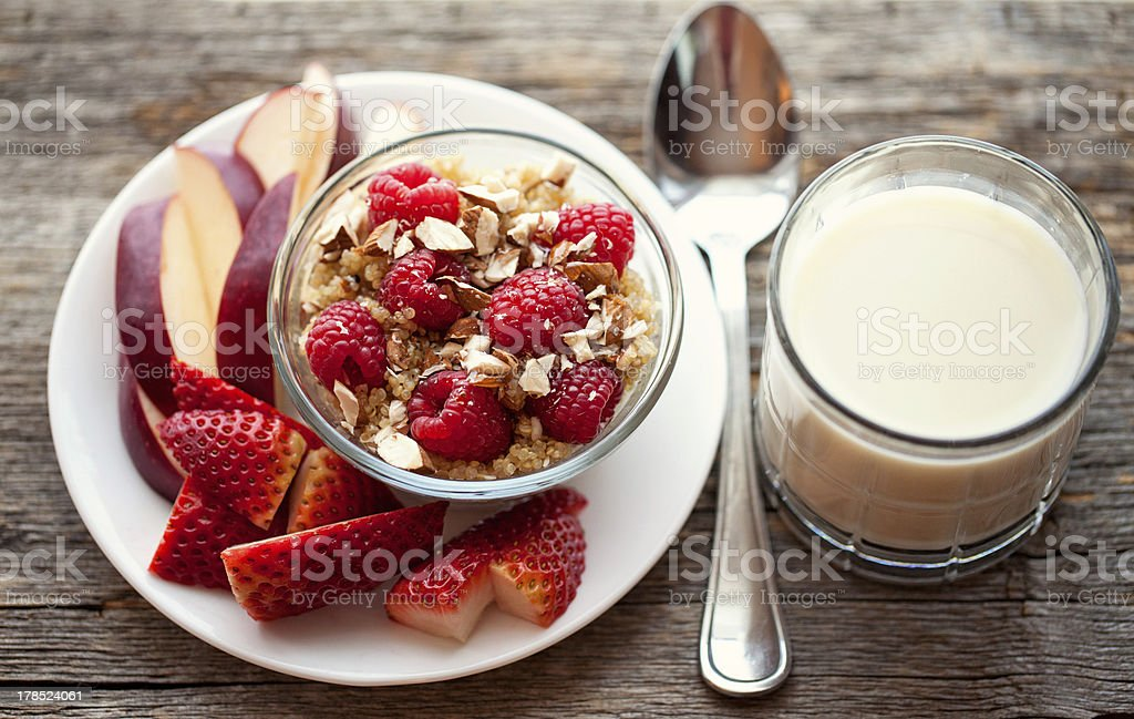 hot Healthy breakfast of Quinoa with chopped nuts fresh fruit stock photo