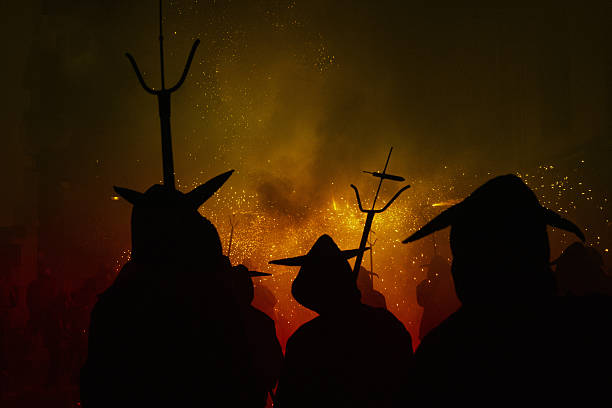 hot hell (catalan festivities) - demon stock photos and pictures