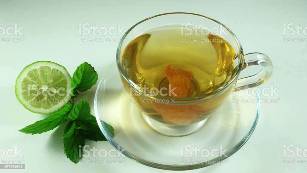 Hot herbal tea in glass cup royalty-free stock photo