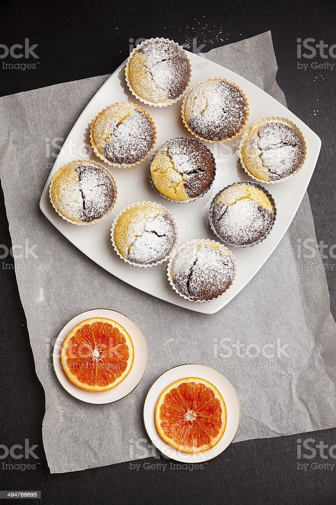 Hot homemade chocolate muffins  on a white plate stock photo