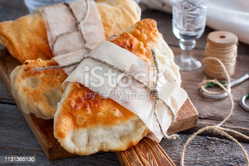 hot homemade pasties on a wooden board