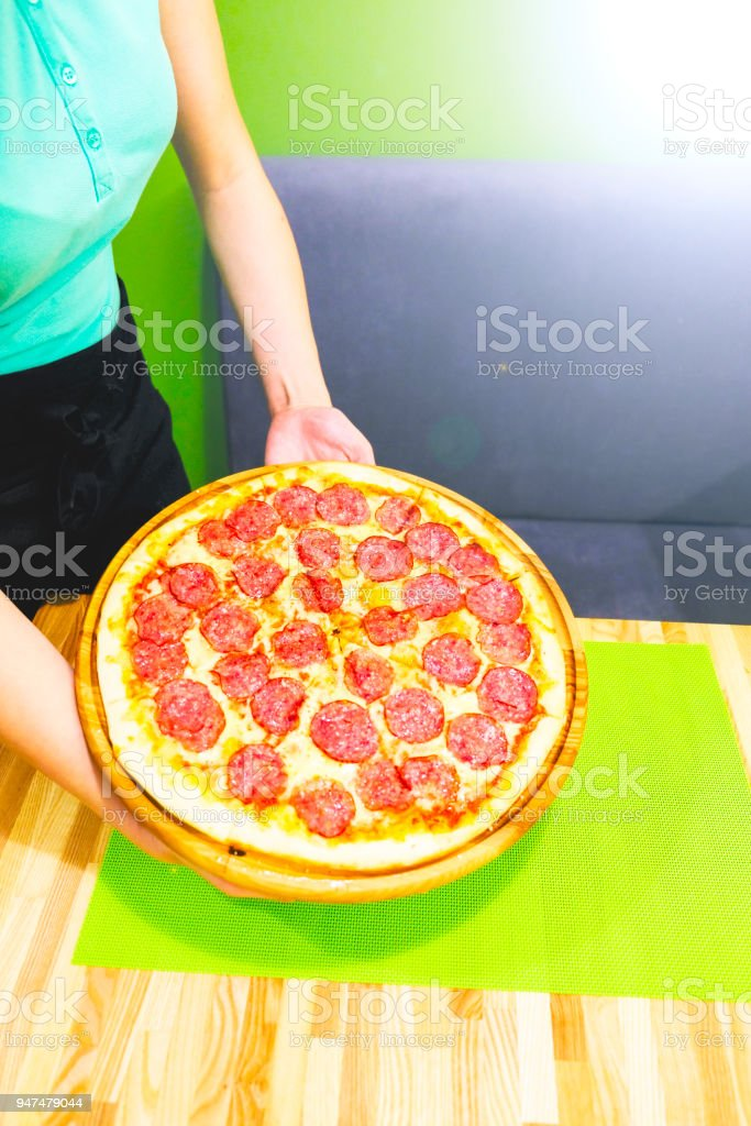 Hot Homemade Pepperoni Pizza Ready to Eat. Bon Appetit stock photo