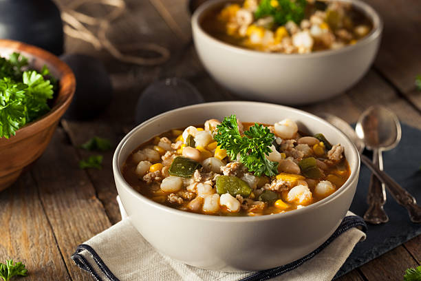 hot homemade white bean chicken chili - bean stock photos and pictures