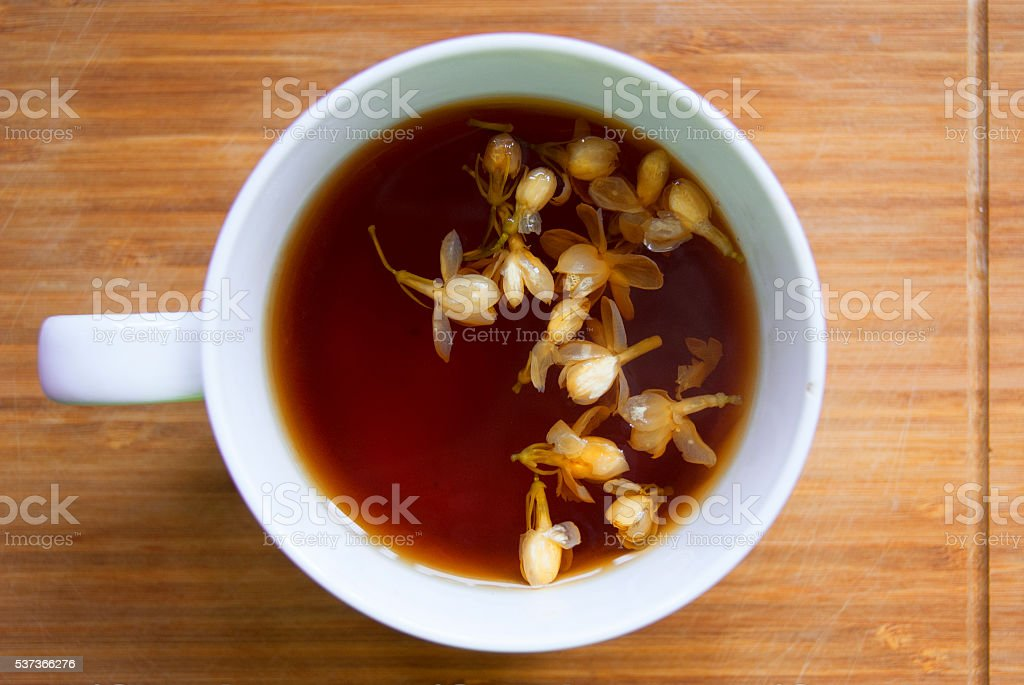 Hot Jasmine Black Tea on Bamboo Cutting Board stock photo