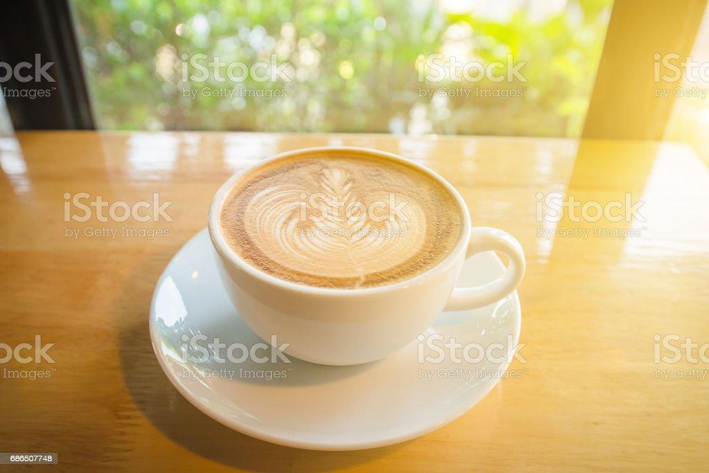 Hot latte art coffee on table royalty free stockfoto