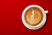 istock hot latte art coffee photo from above top view isolated on red background with clipping path 1300941434