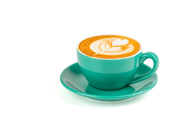 hot latte coffee with latte art in a green cup isolated on white background with clipping path. - tazza foto e immagini stock