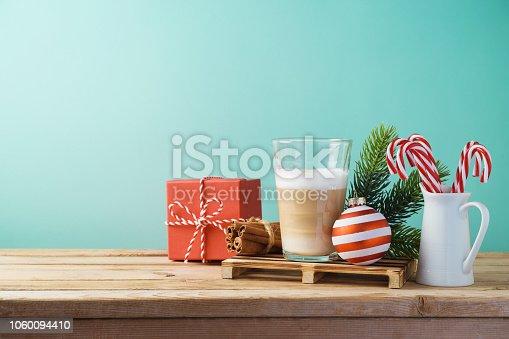 istock Hot Latte macchiato coffee cop  on wooden table. Christmas menu concept 1060094410