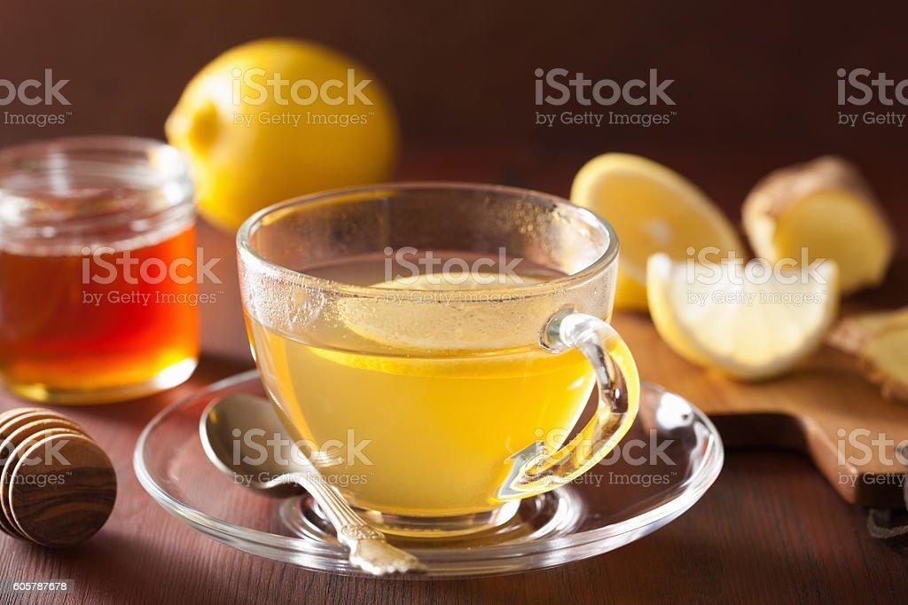 hot lemon ginger honey tea in glass cup stock photo