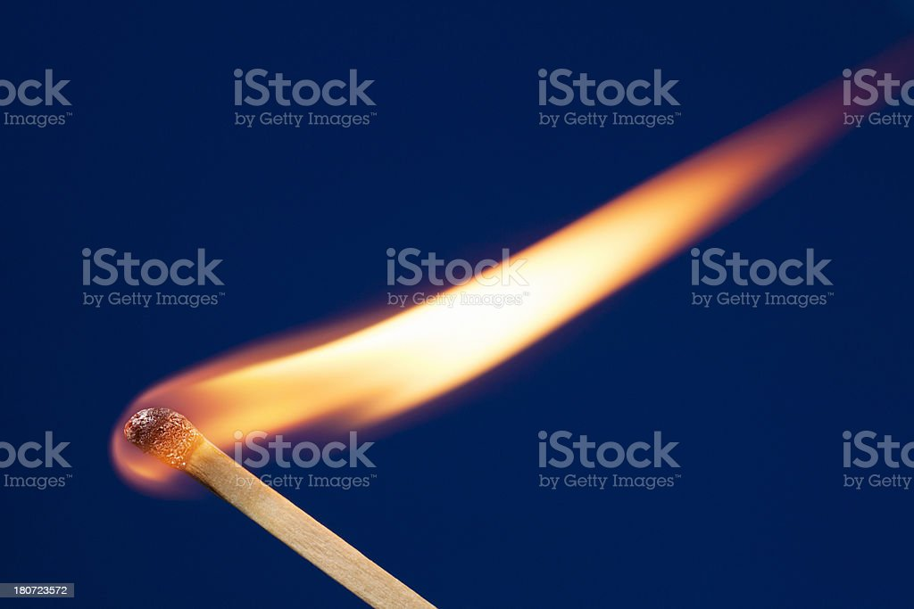Hot Match With Long Flame Blowing in the Wind royalty-free stock photo