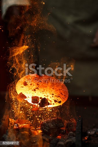 istock Hot metal workpiece for manufacture of clad steel on anvil 525349112