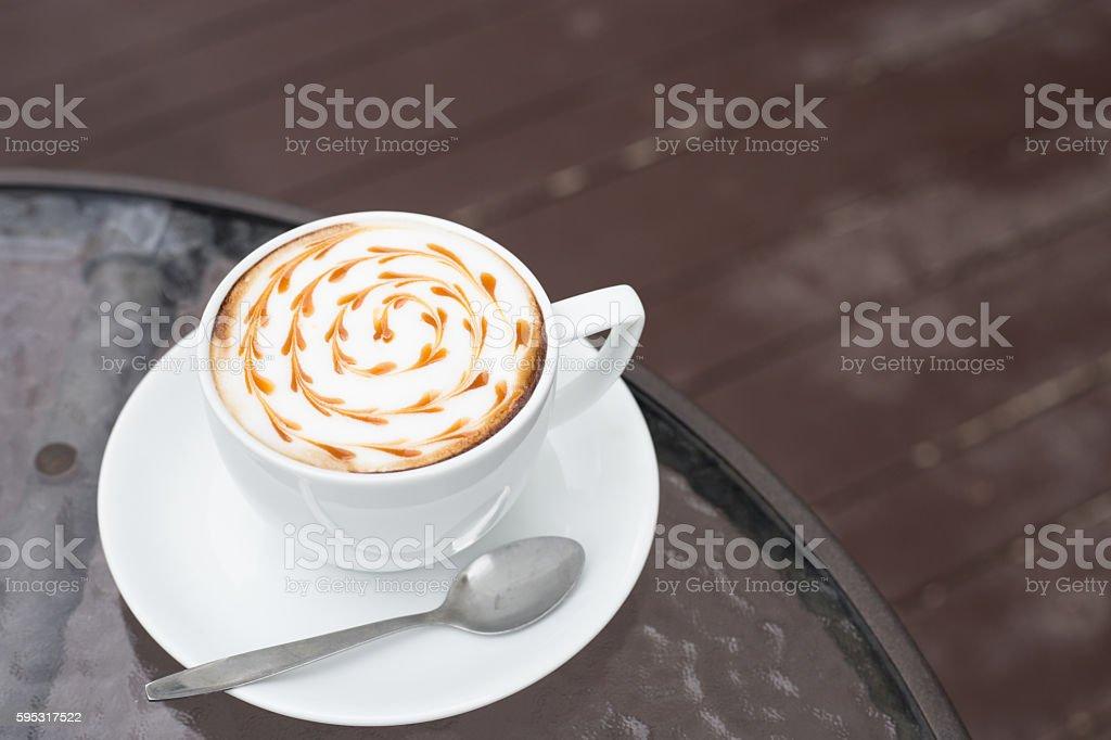 hot milk art coffee on wooden table stock photo
