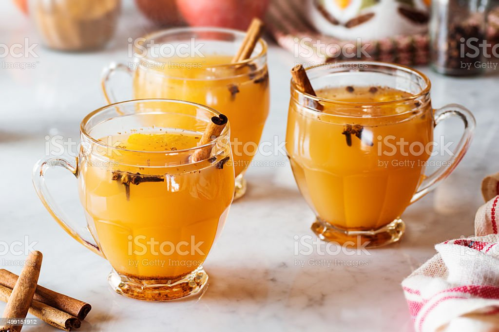 Hot Mulled Spiced Apple Cider with Cinnamon and Cloves stock photo