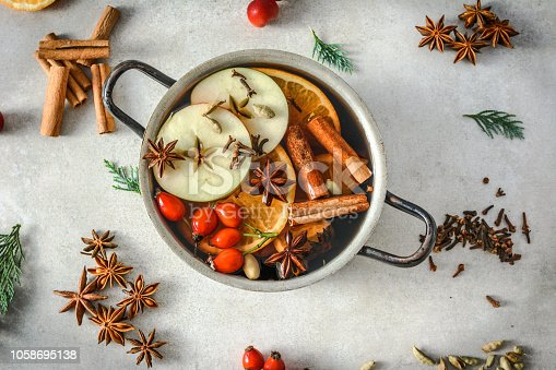 istock Hot mulled wine, christmas cooking 1058695138
