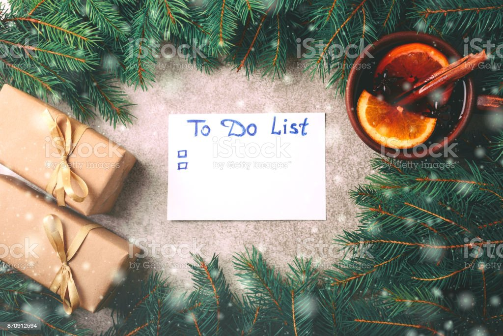 Hot mulled wine, Christmas tree, gifts, cones, to do list stock photo