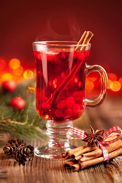 Hot mulled wine with berries stock photo