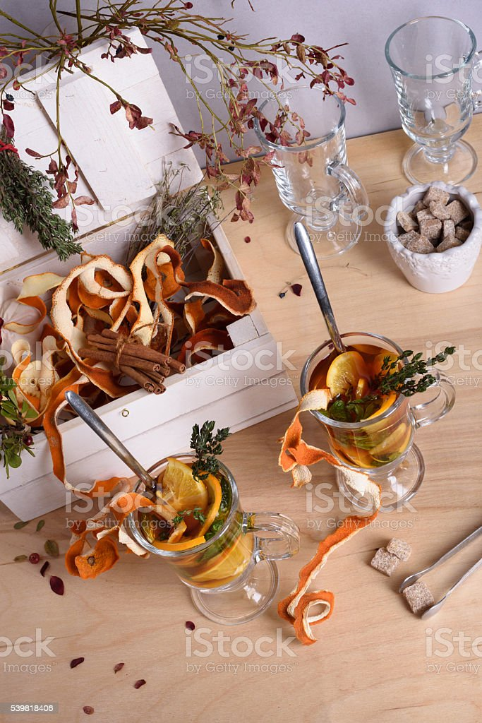 Hot mulled wine with orange slices, cinnamon, thyme. stock photo