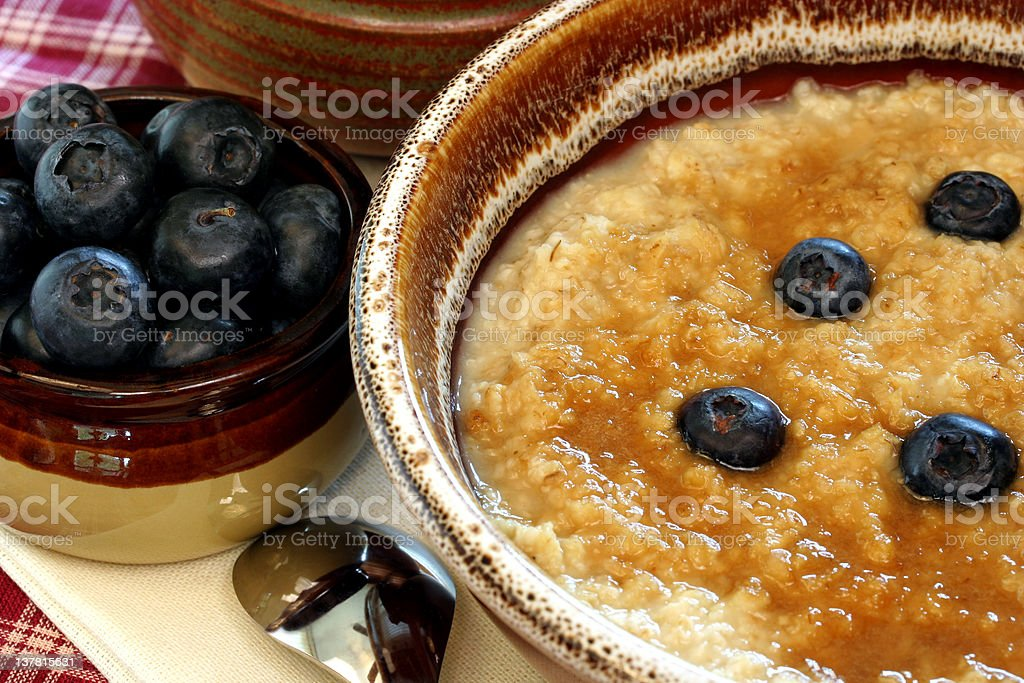 Hot oatmeal and blueberries royalty-free stock photo