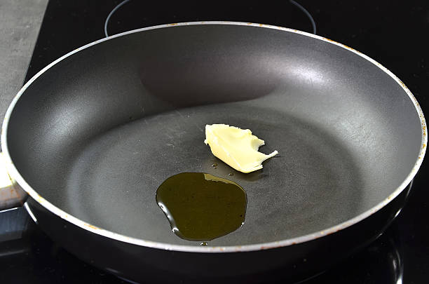 hot pan for cooking with oil and butter photography stock photo