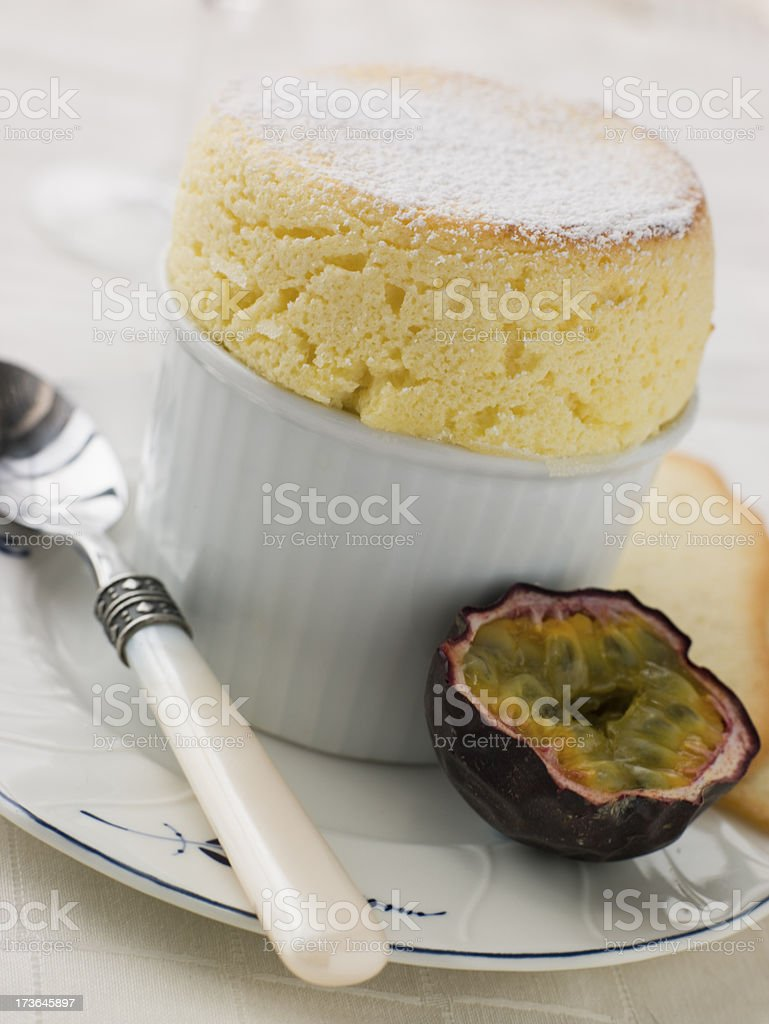 Hot Passion Fruit Souffle with Langue de Chat Biscuits stock photo