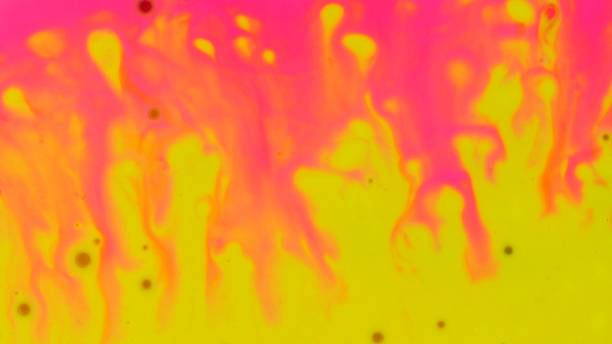 Hot plastic pink and vivid yellow color paint mixing. Blurred abstract background Hot plastic pink and vivid yellow color paint mixing. Blurred abstract background psychedelic stock pictures, royalty-free photos & images