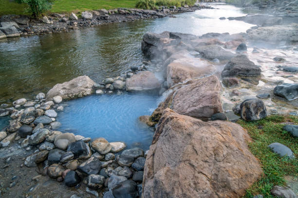 Hot pool by the San Juan River Geothermal heated pool in Pagosa Springs, Colorado. san juan mountains stock pictures, royalty-free photos & images