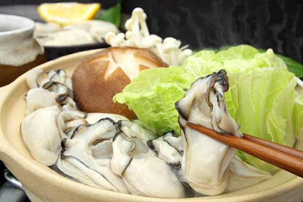 Hot pot A type of Japanese dish consisting of oyster, vegetable and Shiitake mushroom boiled in a pot hiroshima prefecture stock pictures, royalty-free photos & images