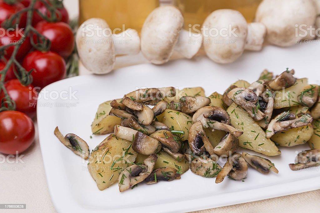 hot potato and mushroom with garnish on white plate royalty-free stock photo