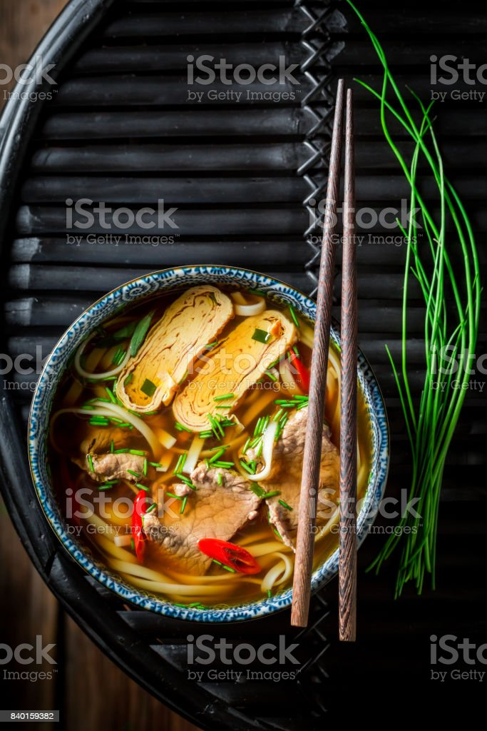 Hot Red Curry soup with beef on dark table stock photo