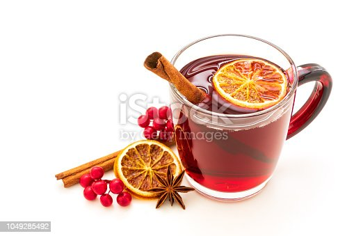 istock Hot red mulled wine isolated on white background with christmas spices, orange slice, anise and cinnamon sticks 1049285492