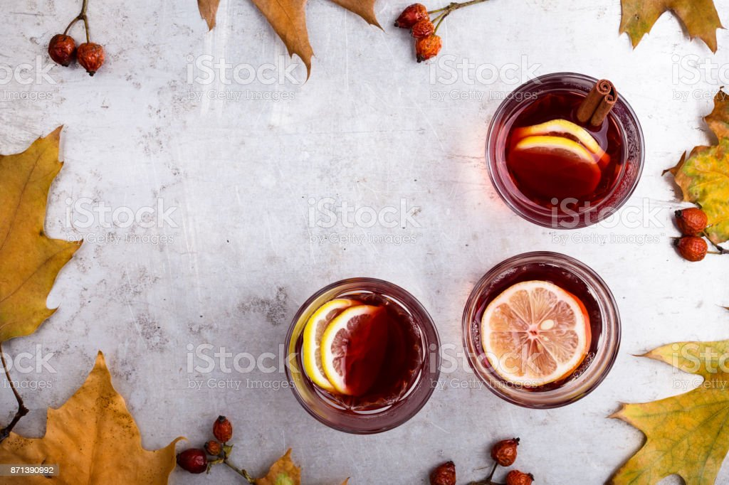 Hot red tea with lemon on light gray table with copy space stock photo