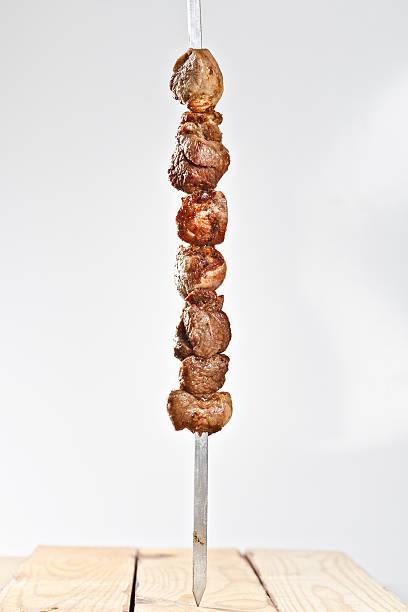hot roasted meat shish kebab on metal skewer stock photo
