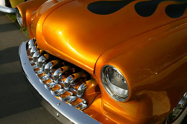Hot rod chorme gril and bumper with orange flames stock photo
