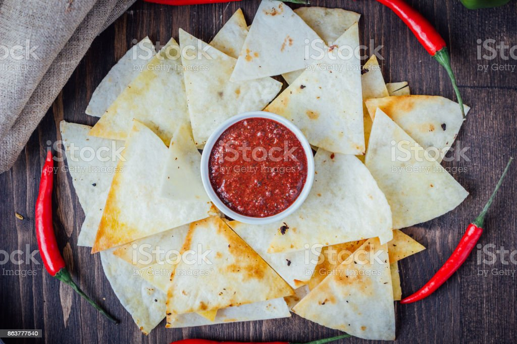 Hot Salsa Dip Over The Hip Of Nachos Chips Organic Home Made