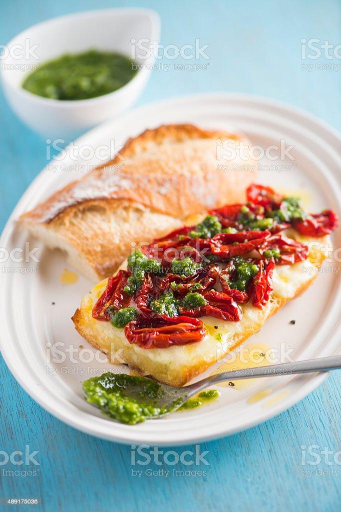 Hot Sandwich with Mozzarella, Sun Dried Tomatoes and Pesto stock photo