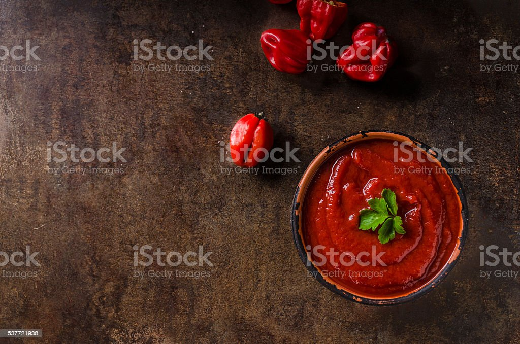 Hot sauce from chilli peppers stock photo