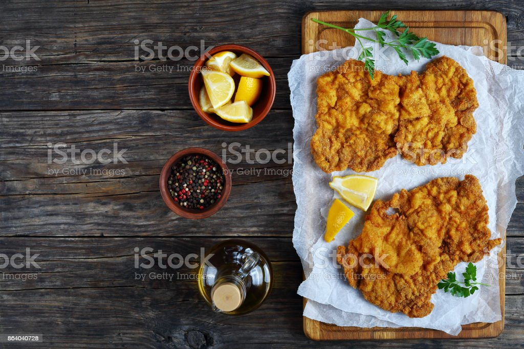 hot schnitzel prepared from veal slices stock photo