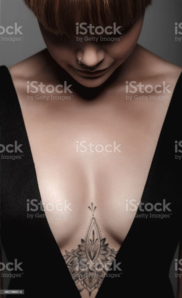 Hot sexy wet girl with tattoo in black stock photo