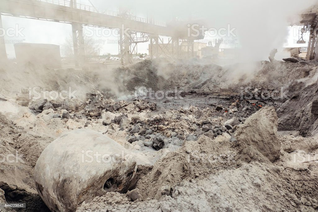 Hot slag dump in metallurgical industry. Heavy industry plant shop. stock photo