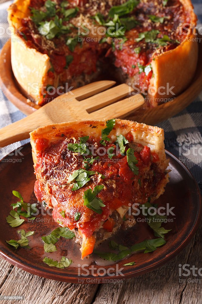 Hot sliced Chicago deep dish pizza closeup on plate. vertical stock photo
