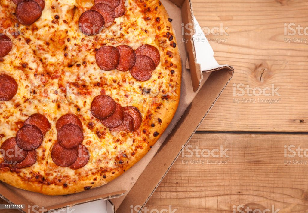 Hot Sliced Pepperoni Pizza In Delivery Box stock photo