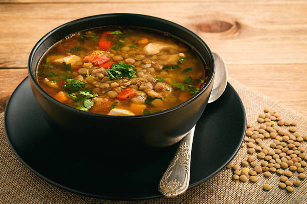 hot soup with green lentil, chicken, vegetables and spices. - lenticchie verdi foto e immagini stock