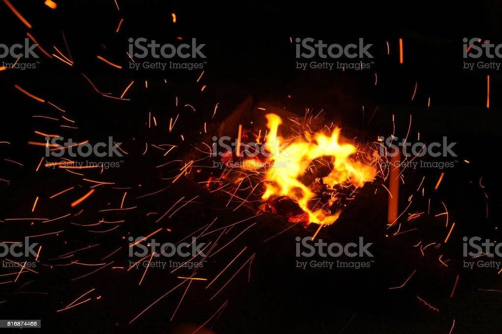 Hot sparking live-coals burning in a barbecue stock photo