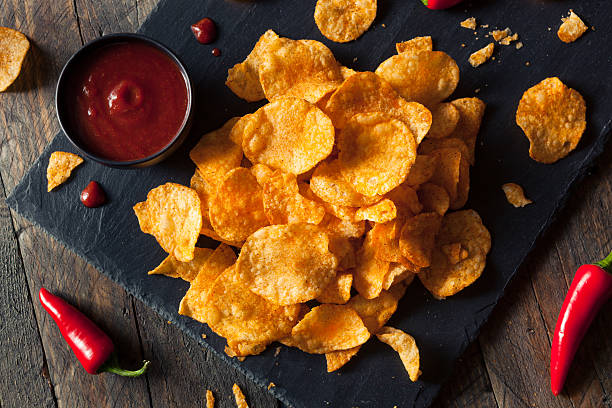 Hot Spicy Sriracha Potato Chips Hot Spicy Sriracha Potato Chips Ready to Eat sriracha tiger zoo stock pictures, royalty-free photos & images