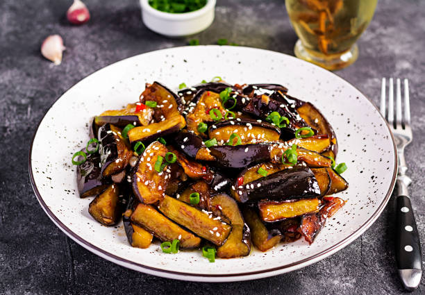 hot spicy stew eggplant in korean style with green onion. aubergine saute. vegan food. - braised stock pictures, royalty-free photos & images