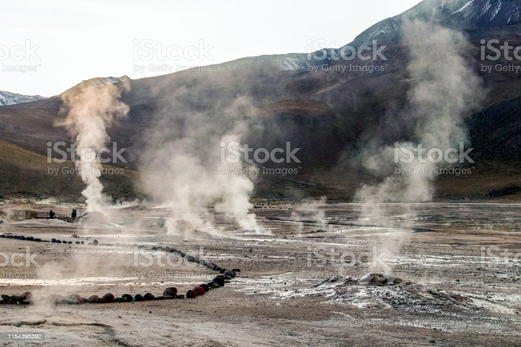 geothermal field with geysers, geyser fountains and hot springs in...