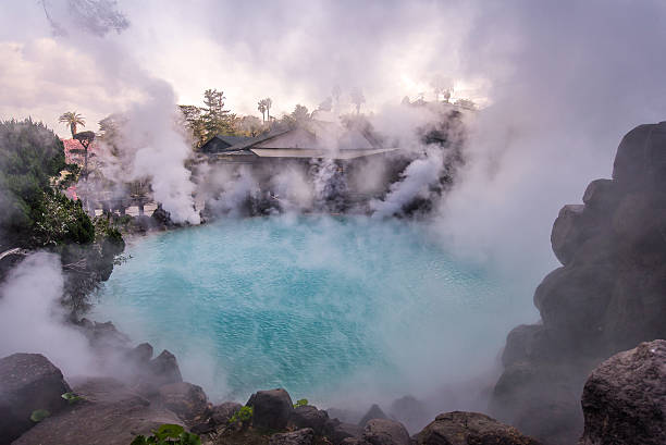 hot spring  (hell) blue water in umi-zigoku in beppu japan. - hot spring stock photos and pictures