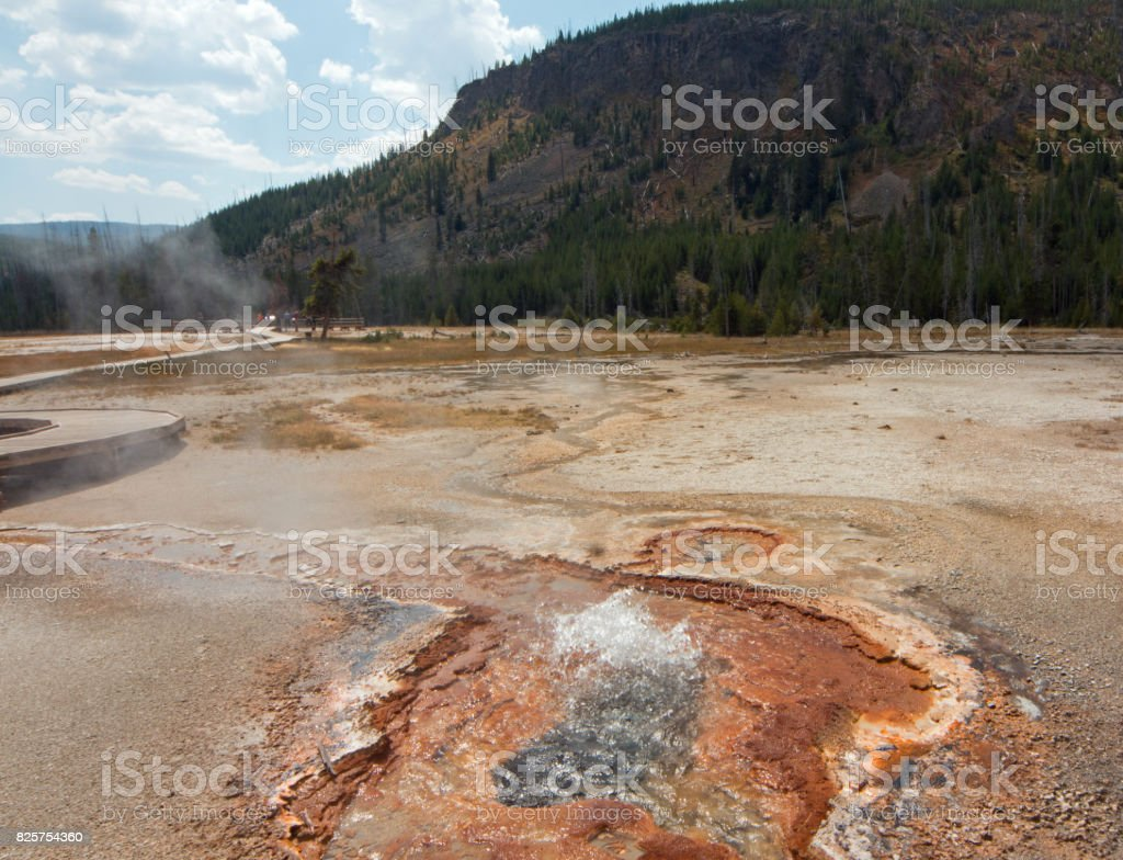 Hot Spring Geyser in Black Sand Basin in Yellowstone National Park in Wyoming United States stock photo